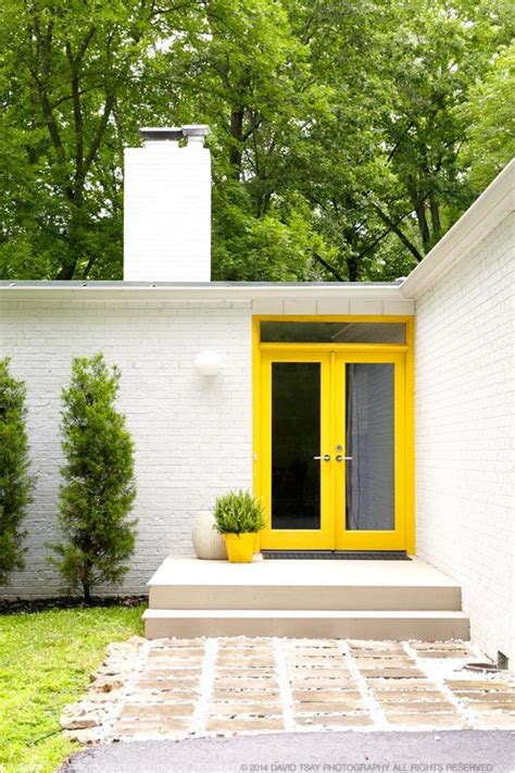 yellow front door 26 bold front door ideas in bright colors shelterness