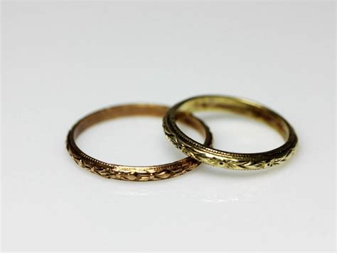 2 tiny antique estate 10k gold baby rings with florets
