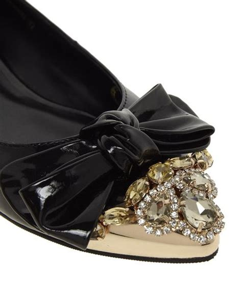 moschino flat shoes moschino black patent bow flat shoes in black