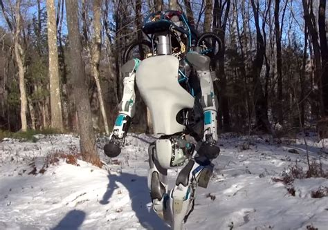 boston dynamics robot robot opens doors picks itself up after getting knocked in