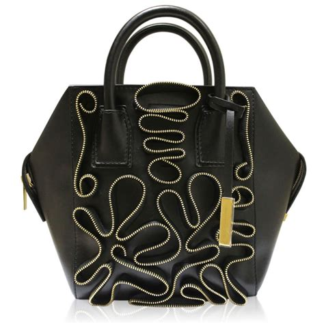 sell designer handbags boca raton