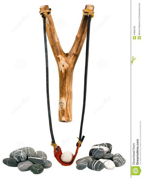 Handmade Wooden Slingshots - handmade wooden slingshot on white stock photo image