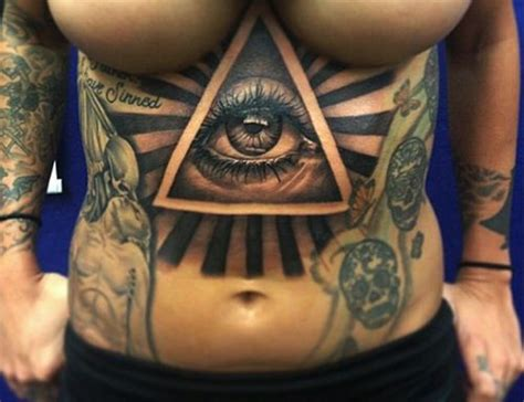 collection of 25 eye pyramid with quote tattoos on forearm