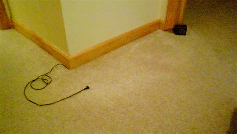 hiding cable wires along wall how to hide any wire along a carpeted wall