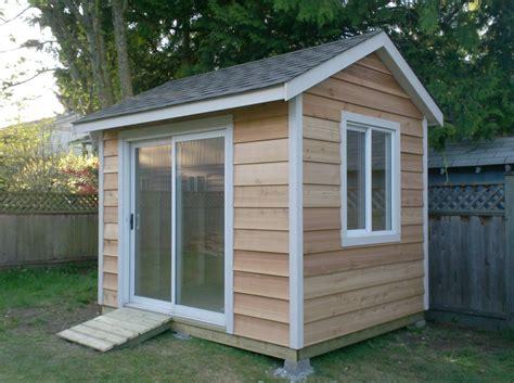 shed  cedar siding   sliding door