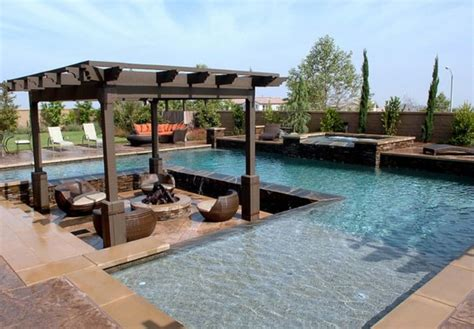 pool area like the sunken patio in pool area outdoor conversation