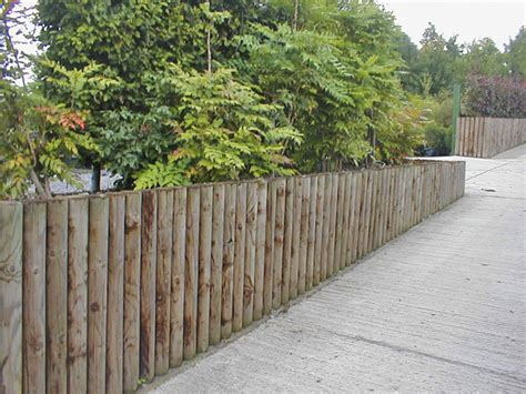 wood post retaining wall pictures to pin on pinterest