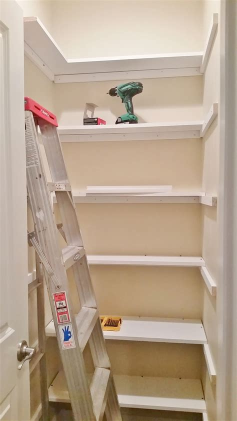 Building Pantry Shelves by Kitchen Pantry Makeover Replace Wire Shelves With Wrap Around Wood Shelving For 130 Diy