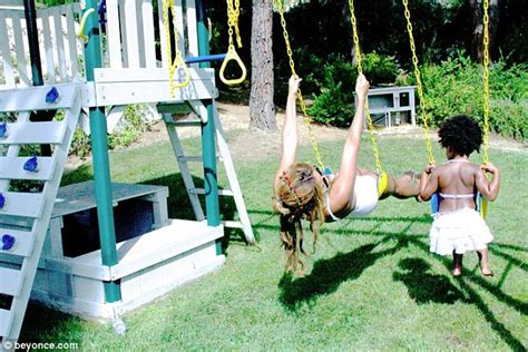 beyonce swing bikini clad beyonce has a swinging good time with daughter