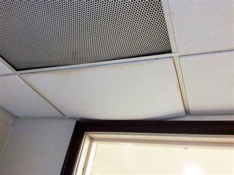 sagging ceiling tiles ceiling tile sagging bathroom door picture of