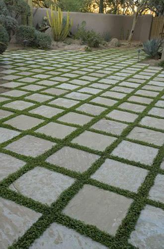 outdoor tile with grass instead of grout tile