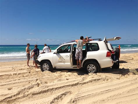 jeep with surfboard top 10 things to do on stradbroke island fleetcrew