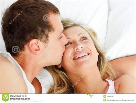 kissing in the bed boyfriend kissing his girlfriend in bed stock photo image 10946160