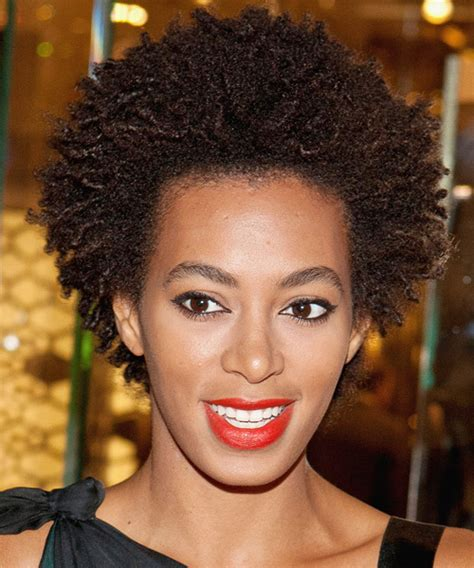 which older pam or twa solange knowles short curly casual afro hairstyle dark
