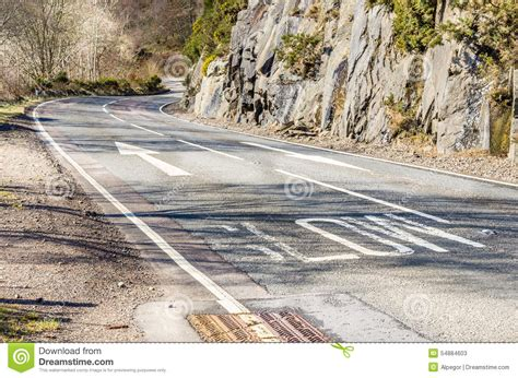 paving the road to inspired empowerment thought reflection t a r books signs painted on asphalt stock photo cartoondealer