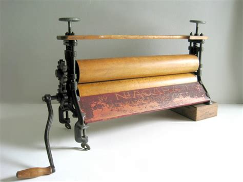 Imaginehand Pressing Your Garments by Antique Laundry Clothes Mangle Wringer Press Farmhouse