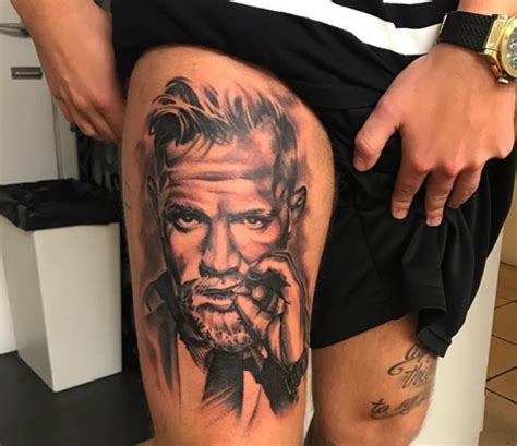 conor mcgregor back tattoo michael bisping and conor mcgregor tattoos by ufc
