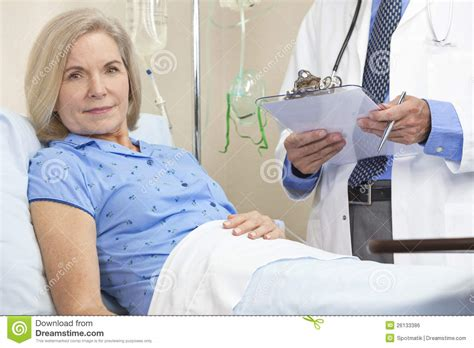 woman in hospital bed senior female woman patient in hospital bed stock photo