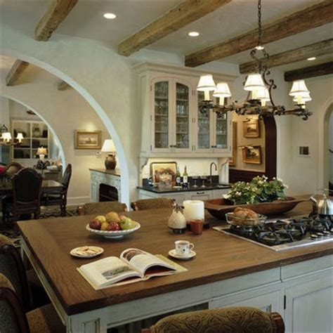 kitchen island with cooktop and seating mediterranean
