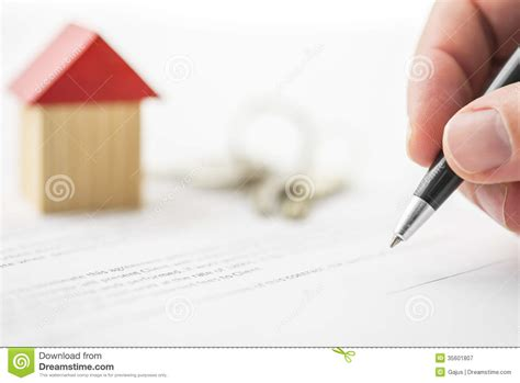 buying a house signing contract signing contract of house sale royalty free stock photography image 35601807