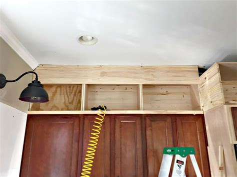 how to construct kitchen cabinets building cabinets up to the ceiling from thrifty decor