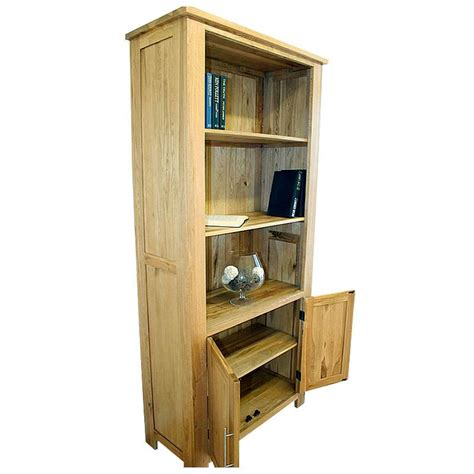 50 solid oak bookcase with cupboard doors delamere