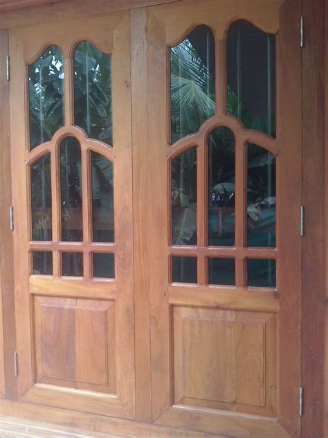 home windows design in wood bavas wood works kerala style wooden window door designs
