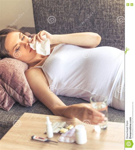 having on couch pregnant woman having cold stock photo image 75776047