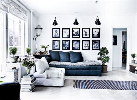 navy blue and living room living room white blue navy gray black sconces light wall gallery pictures frames stacked books