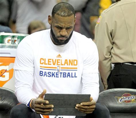 lebron james bench lebron james the only cavs player using an ipad on the