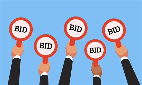 auction bid buyers raising auction bid paddles with numbers of