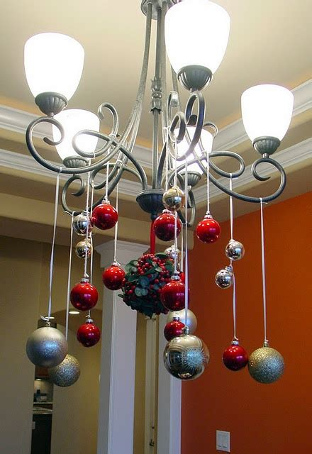 ornaments hanging from the chandelier o tannenbaum