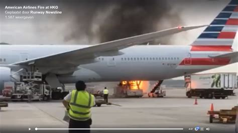 cargo loader bursts into flames as they are loading an american airlines boeing 777 at hong kong