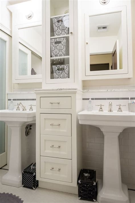 cabinet between bathroom sinks double pedestal sinks with storage drawers in between