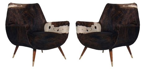 italian mid century modern club chairs covered in cowhide