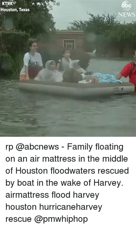 houston news rp family floating on an air mattress in the middle of houston floodwaters