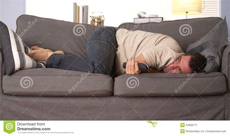 having with a couch guy having trouble sleeping stock photo image 44820771