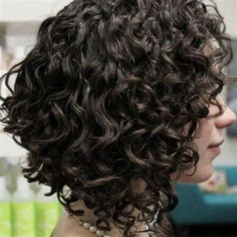 angled cut outward curl hairstyles 50 ravishing short curly hairstyles hair motive hair motive