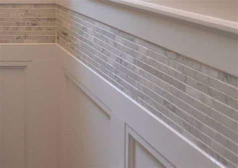 Wainscoting with tile border above   House Ideas