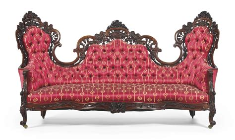A Rococo Revival Rosewood Laminated Sofa Attributed To