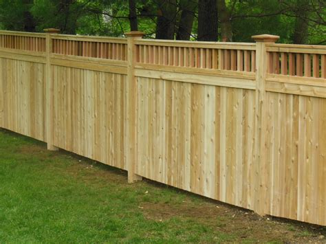 a wood cedar privacy fence featuring tongue and