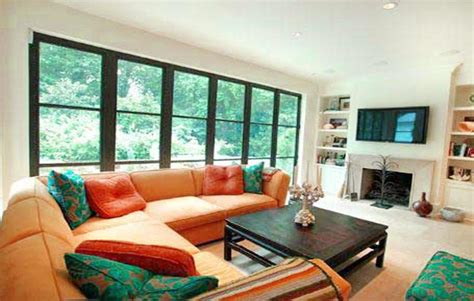 arrange a room arranging living room furniture with fireplace and tv