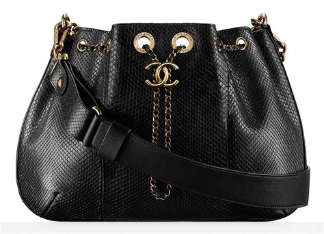 Other Designers Sang A Pleated Python Evening Clutch by Chanel S Designer Handbags Watches Shoes Clothes