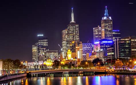 melbourne night light reflecting in the water wallpaper