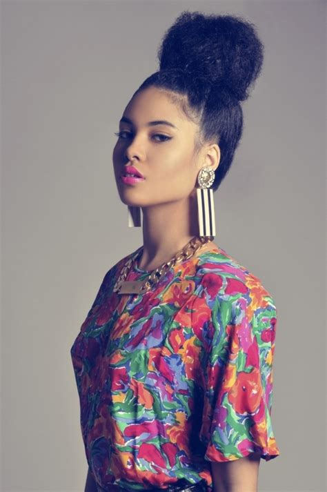 pics of black women pretty big hair buns with added hair top knot 7 super cute curly hairstyles for fall that you