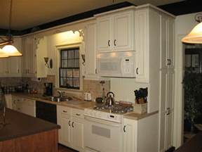 Repaint Kitchen Cabinets by Pro Secrets For Painting Kitchen Cabinets This Old House