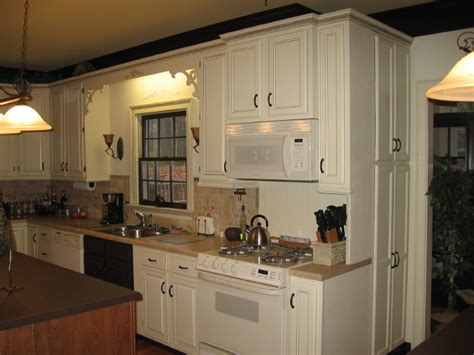 painted kitchen cupboards pro secrets for painting kitchen cabinets this old house