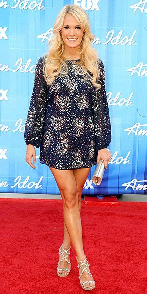 Carrie Underwood With Their Clutches by Carrie Underwood Wearing A Badgley Mischka Mini With