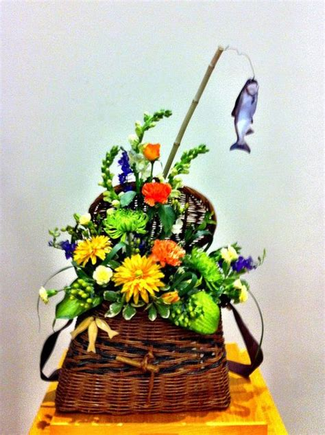 flower arrangement pictures with theme flowers in a fishing creel flowers pinterest church