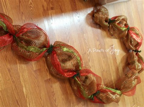 how to add wide mesh ribbon garland to a christmas tree how to make a simple mesh garland
